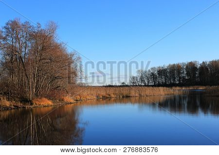 Beautiful lake in autumn forest. Autumn forest reflected in the lake. Autumn landscape. Beautiful autumn yellow forest reflected on the water. Yellow autumn trees. Autumn nature. Russian forest. The northern forest. Nature Reserve. The autumn yellow woods