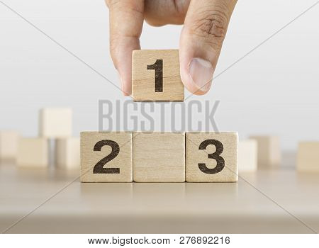 Hand Arranging Wooden Blocks Stacking As A Podium On White Background. Success, Win, Winner, Victory