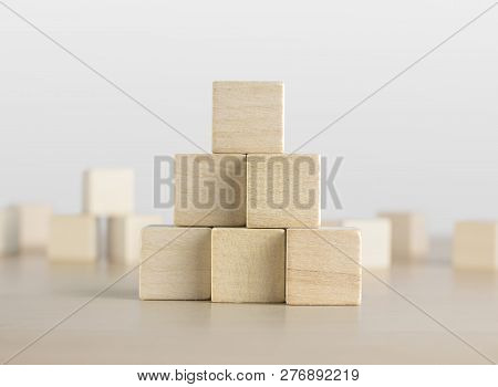 Wooden Blocks Stacking As A Pyramid Staircase On White Background. Success, Growth, Win, Victory, De