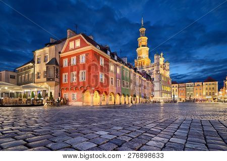 Stary Rynek Square With Small Colorful Houses And Old Town Hall At Dusk In Poznan, Poland