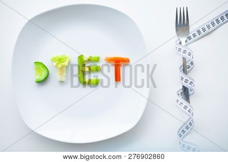 Diet Or Weight Control Concept. Close Up Of Plate With Vegetable Diet Letters. Fitness And Healthy F