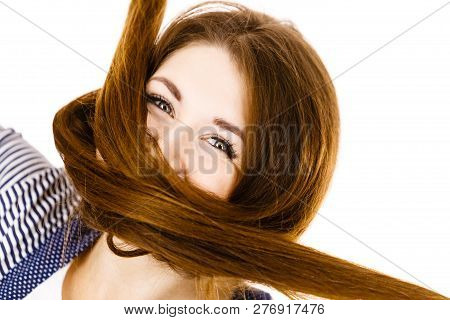 Haircare and hairstyling concept. Woman having face covered with her dark brown hair. poster