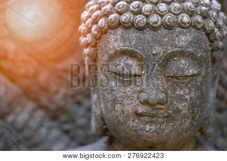 Rock Buddha Statue With Sunlight Used For Amulets Of Buddhism Religion. Buddhism Is Popular Region I