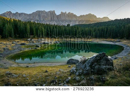 Reflection Of The Dolomite Dolomar Mountain Range In The Clear Waters Of The Karersee Carezza Lake I