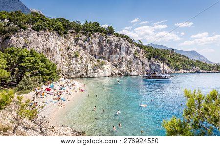 Makarska, Croatia - July 19, 21018: Tourists Relaxing At Marvelous Nugal Beach Near Makarska Village