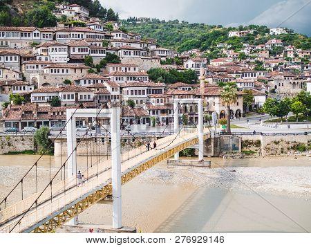Berat, Albania - June, 2018: Pedestrian Bridge Over The Osum River In The Old Town Of Berat