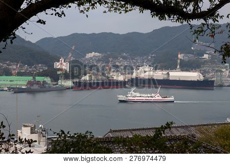 Nagasaki, Japan - October 26,2018: Nagasaki port with ferries and cruiseboats surrounded by mountains