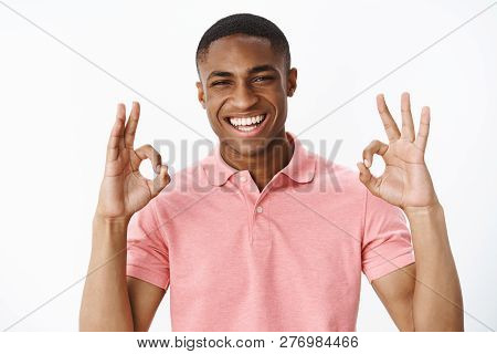 Portrait Of Ambitious Good-looking African American Young Positive Guy Showing Okay Gesture With Bot