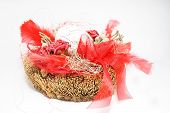 One Decorative Easter Egg in Basket with red feather poster