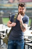 Looking for accommodations. Hipster thoughtful traveler carry travel bag. Business trip. Man bearded traveler hipster travel with luggage bag. Let travel begin. Traveler with bag arrive destination. poster