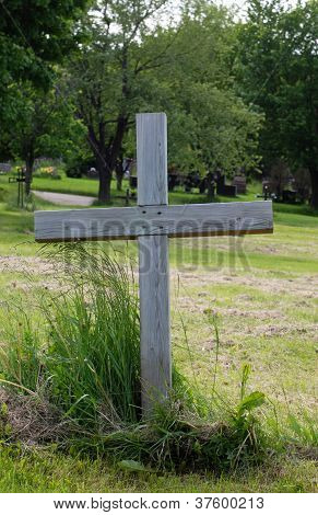 Single Wood Cross In A Cemetery