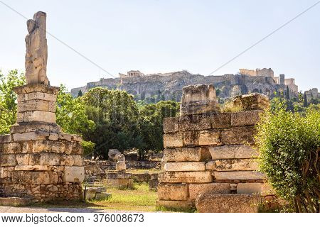 Ancient Agora In Summer, Athens, Greece. Classical Greek Ruins Overlooking Acropolis Hill. Urban Lan