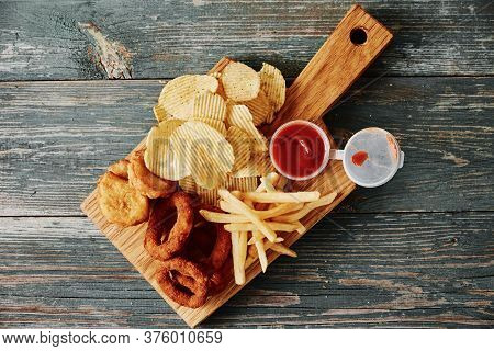 Unhealthy And Junk Food. Different Types Of Fastfood And Snacks On The Table, Close Up. Takeaway Foo