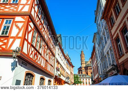 Mainz, Germany, August 24, 2019: Traditional German Houses With Typical Wooden Wall Fachwerk Style A