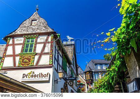 Rudesheim Am Rhein, Germany, August 24, 2019: Traditional German Houses And Beautiful Art Buildings
