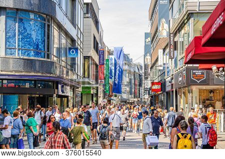 Cologne, Germany, August 23, 2019: Crowd Of People Tourists Walking Down Pedestrian Shopping Street