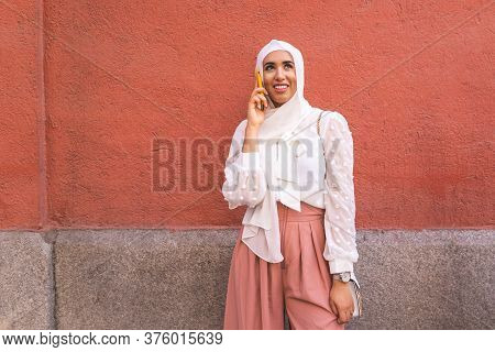 Beautiful Arab Girl Having Phone Call Outdoors. Lifestyle Concept.