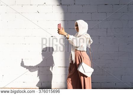 Beautiful Arab Girl Taking Selfie Outdoors. Lifestyle Concept.