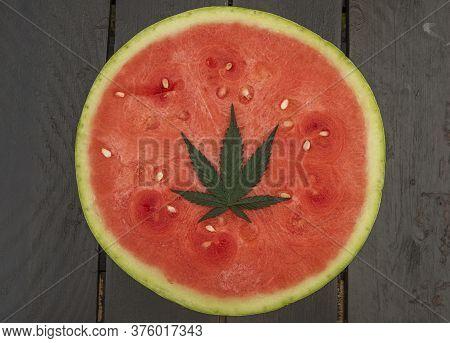 Red Sweet Seedless Melone With Green Marijuana Leaf