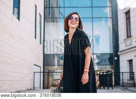 Beautiful Modern Middle-aged Female Laughing At Camera Portrait Dressed Black Dress And Sunglasses W