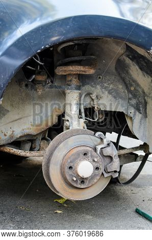 Close Up Of Break Disc On Car In Process Of New Tire Replacement. Car Wheel Repair, Wheel And Brake