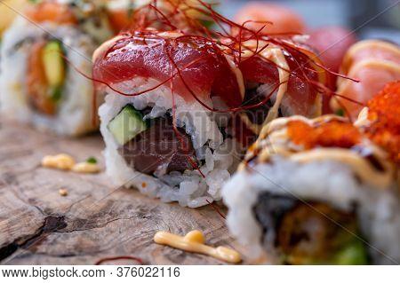 Japanese Food, Sushi Or Sashimi Made From Rice With Raw Tuna, Avocado, Cucumber, Red Fish Caviar, Te