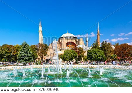 Hagia Sophia Ayasofya Museum With Fountain In The Sultanahmet Park In Istanbul, Turkey During Sunny
