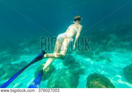Snorkeler Female In Ko Surin Marine National Park, Underwater Scene. Woman Snorkeling Activity In Wh