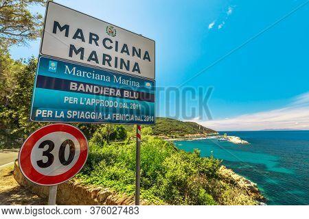 Marciana Marina, Elba Island, Italy - June 18, 2020: Welcome Sign Marciana Marina Blue Flag For La F