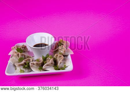 Plate Of Steamed Dumpling Appetizers With Soy Sauce