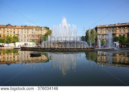 Fountain Of Piazza Castello On A Spring Sunny Day. City Of Milan, Region Of Lombardy, Italy, Europe.