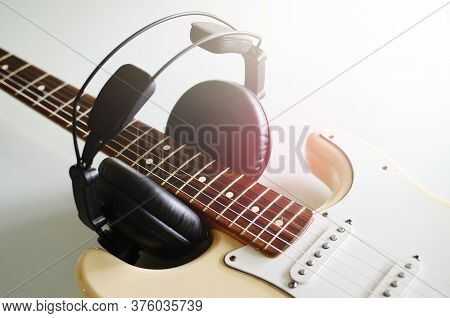 Electric Guitar , Macro Abstract And Headphones, Used To Play Music And Notes.