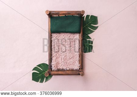 Newborn Digital Background - Brown Wooden Bed On Pink Background With Monstera Plant Leaves, Green P