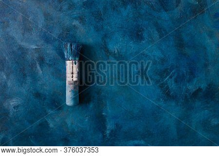 Brush On Top Of Finished Work Of An Abstract Textured Painting Or Photography Backdrop With Blue And