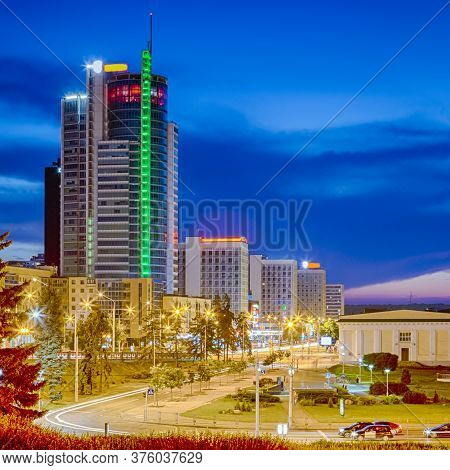 Belarus Travel Destinations. Minsk City Night View With Pobediteley Avenue And Newly Built Houses At