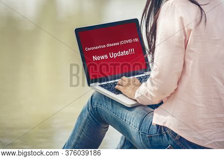 Coronavirus News Update For Covid-19 Pandemic Crisis Quarantine Woman Checking News On Laptop Screen