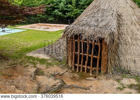 Closeup Front View Of Straw Thatched Hut At Prehistoric Archeological Site In Daejeon, South Korea.