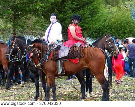 Cuenca, Ecuador - October 7, 2018: Local Celebration At Village. Group Of People Dressed In Funny Co