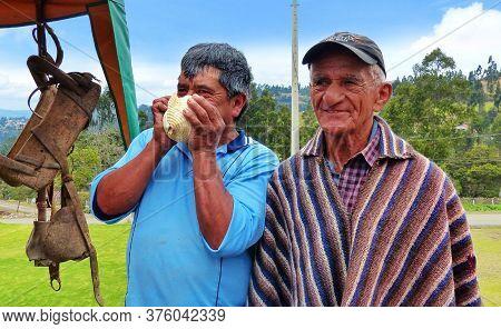 Cuenca, Ecuador - October 7, 2018: Two Ecuadorian Senior Men From Village. One Is Dressed In Typical