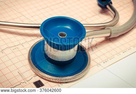 Medical Stethoscope And Electrocardiogram Graph Report. Ekg Heart Rhythm. Medicine And Healthy Lifes