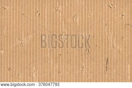 Rough and torn corrugated cardboard texture. Shabby and rough empty cardboard recycled material background.