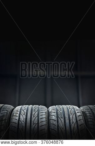 Car Tires At Warehouse In Tire Store.black And White Tone,copy Space