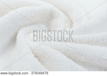 Towel texture closeup. Soft white cotton towel backdrop, fabric background. Terry cloth bath or beach towels. Soft fluffy Textile. Macro, texture