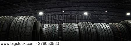 Car Tires At Warehouse In Tire Store.black And White Tone,banner Side