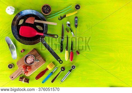 Kitchen Utensils On A Wooden Background. Various Kitchen Utensils On Wooden Table. Chef Tools. Home