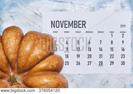 Simple November 2020 Calendar Decorated With Pumpkins On Bright Background. View From Above. Top Vie