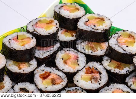 Top View Of Stack Of Japanese Sushi Maki Roll Plate. Served In Japanese Bar Restaurant With Chopstic