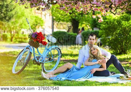 Perfect Spring Date. Long Lasting Relationship. Couple Having Picnic In Local Park. Couple Sit Blank