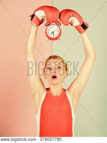 Establishing The Clock Time. Time To Fight. Time For Success. Win The Day. Surprised Woman Boxing Gl