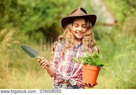 Planting Plants. Happy Childhood. Child In Hat With Shoulder Blade Small Shovel Hoe. Happy Smiling G